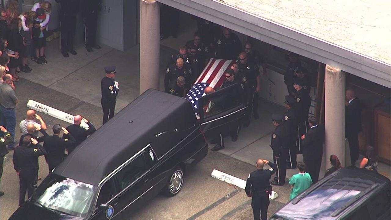 This image shows a procession for San Jose police Officer Michael Katherman on June 16, 2016.