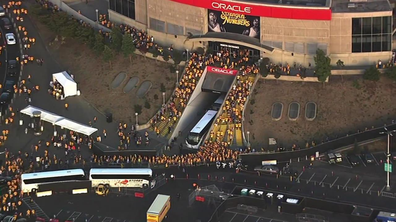 A large crowd is seen leaving Oracle Arena in Oakland, Calif. following Game 7 of the NBA Finals on Sunday, June 19, 2016.