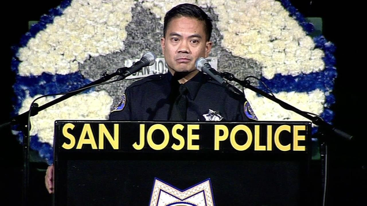 Ofc. Chau Pham honored fallen San Jose Ofc. Michael Katherman during his memorial at the SAP Center in San Jose on Tuesday.
