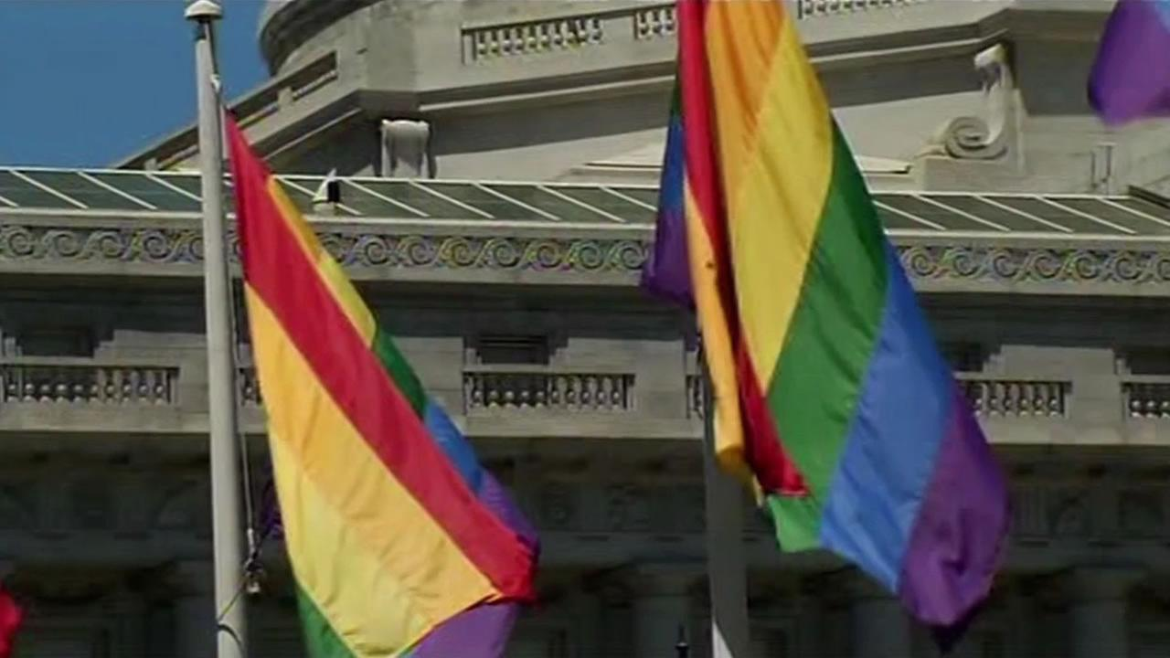 This image shows pride flags waving at San Francisco City Hall on June 24, 2016.