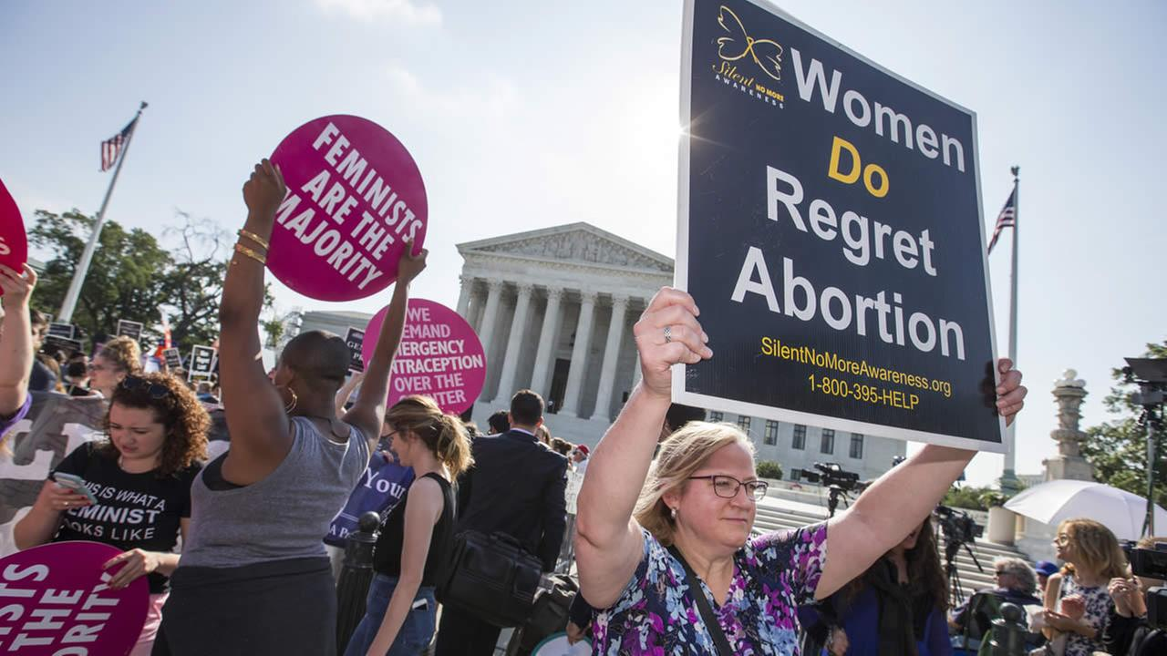 Activists demonstrate in front of the Supreme Court in Washington, Monday, June 27, 2016, as the justices close out the term with decisions on abortion.