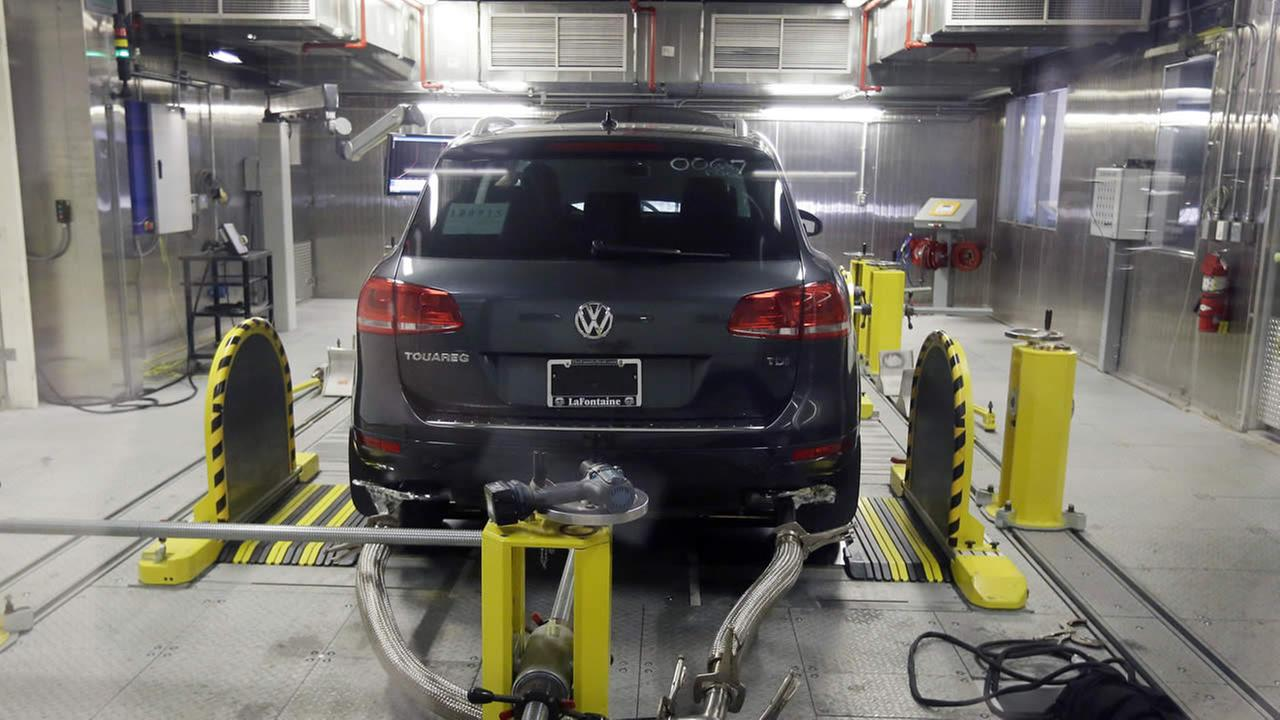 FILE - In this Oct. 13, 2015, file photo, a Volkswagen Touareg diesel is tested in the Environmental Protection Agencys cold temperature test facility in Ann Arbor, Mich.