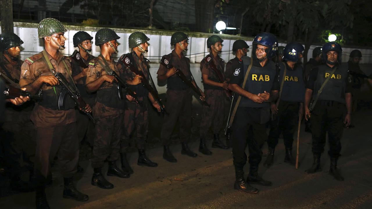 Bangladeshi security personnel cordon off the area after a group of gunmen attacked a restaurant popular with foreigners in a diplomatic zone of the Bangladeshi capital Dhaka.