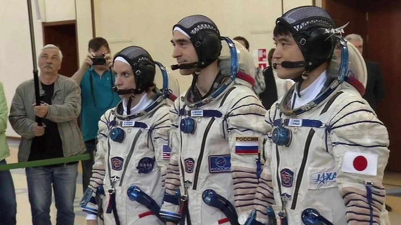This image shows astonaut and biologist Kate Rubins and two other astronauts who are headed to the International Space Station on a Soyuz spacecraft on July 6, 2016.