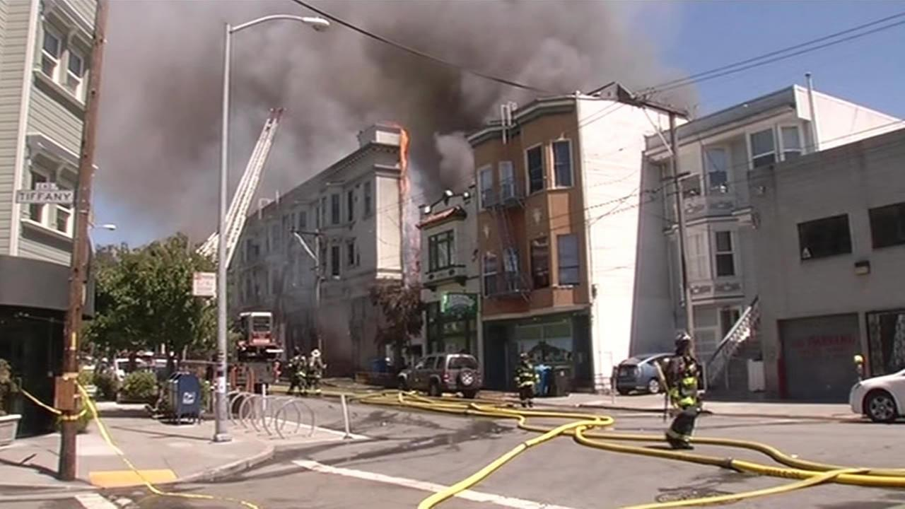 This image shows smoke pouring out of a building on Mission and 29th streets in San Francisco on June 18, 2016.