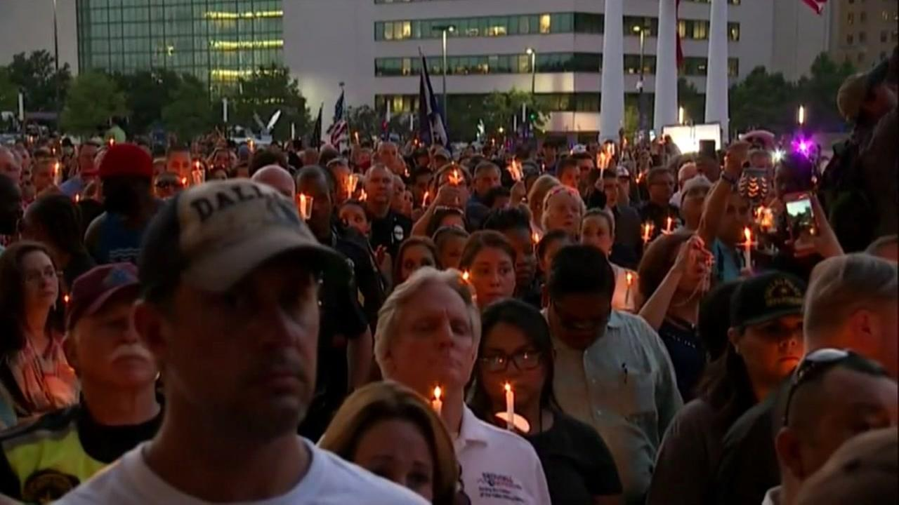 A crowd gathers for a vigil to honor five fallen Dallas officers on Monday, July 11, 2016.