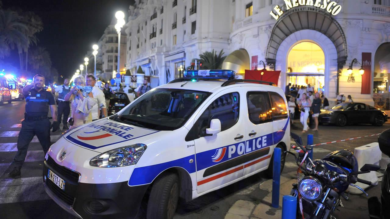 A Police car is at the scene of an attack after a truck plowed through a crowd of revelers whod gathered to watch the fireworks  in Nice, France on July 15, 2016. (AP Photo)