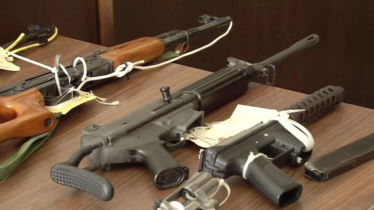 This image shows firearms seized from criminals in Oakland that were on display July 15, 2016 in courtroom in Oakland, Calif.