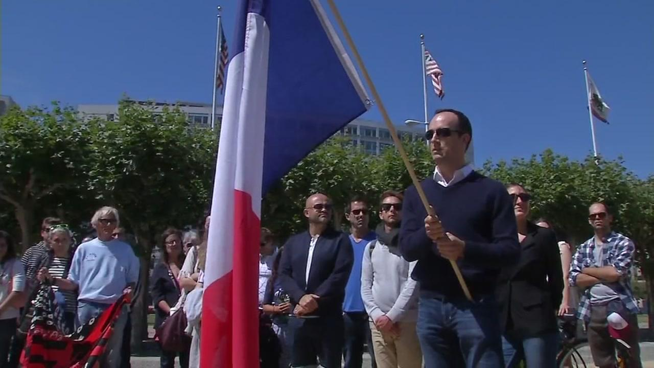 This image shows a vigil for Nice, France at San Francisco City Hall on July 16, 2016.