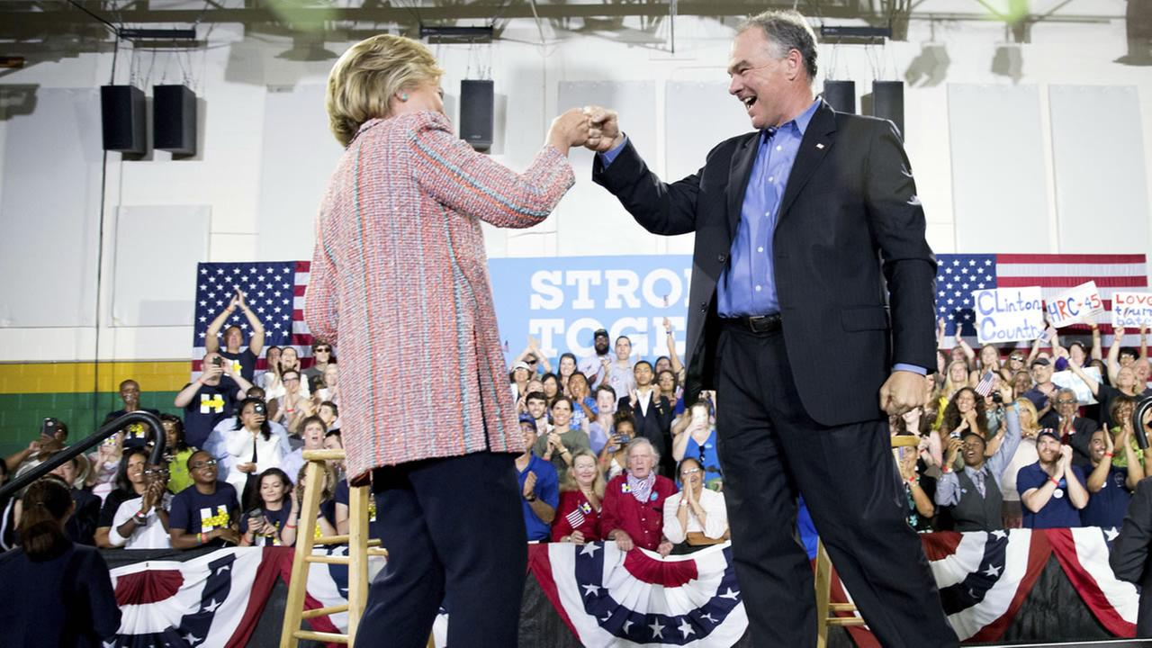 Democratic presidential candidate Hillary Clinton fist bumps Sen. Tim Kaine, D-Va., after speaking at a rally at Northern Virginia Community College in Annandale, July 14, 2016.
