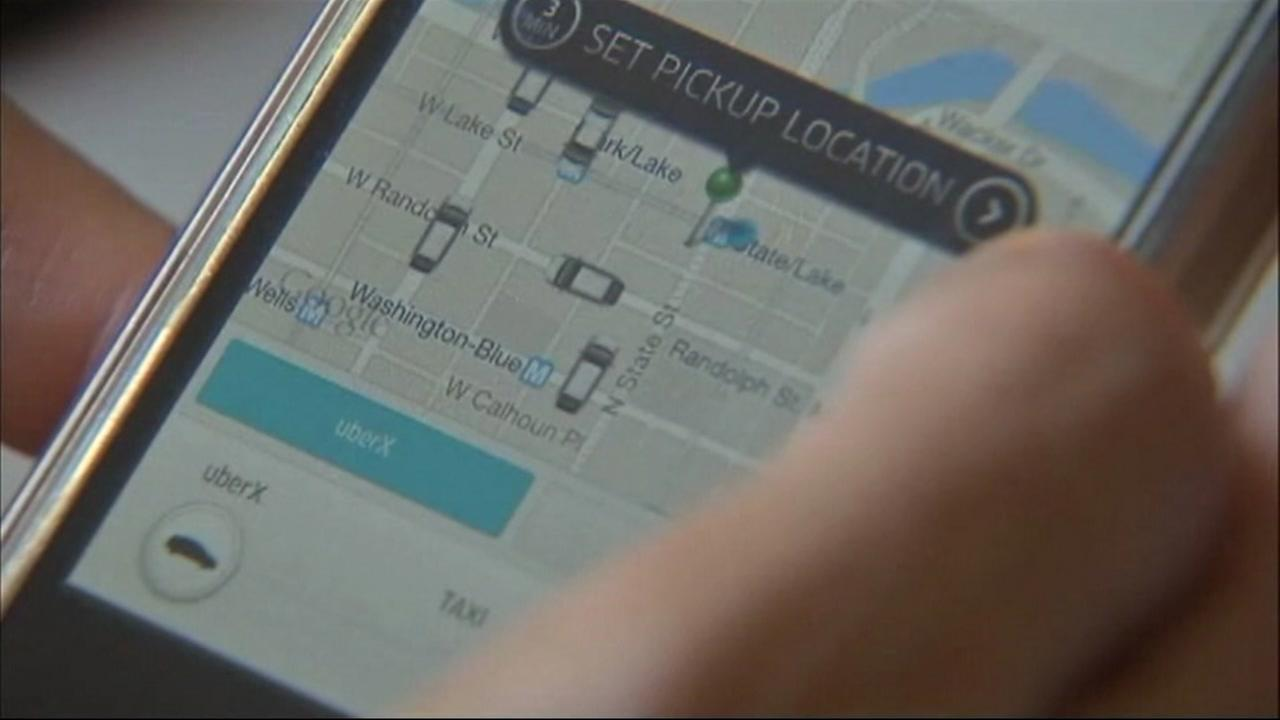 An Uber app is seen on a smartphone in this undated image.