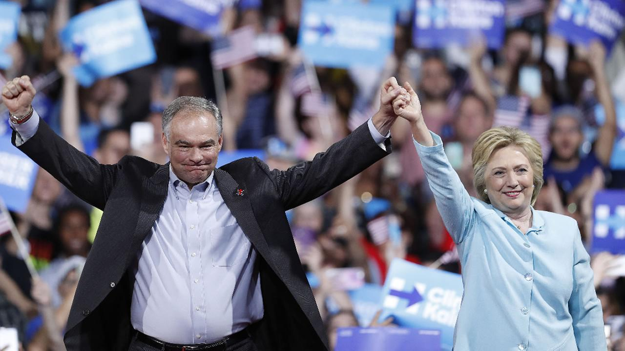 Democratic presidential candidate Hillary Clinton and Sen. Tim Kaine arrive at a campaign rally at Florida International University Panther Arena in Miami, Saturday, July 23, 2016.