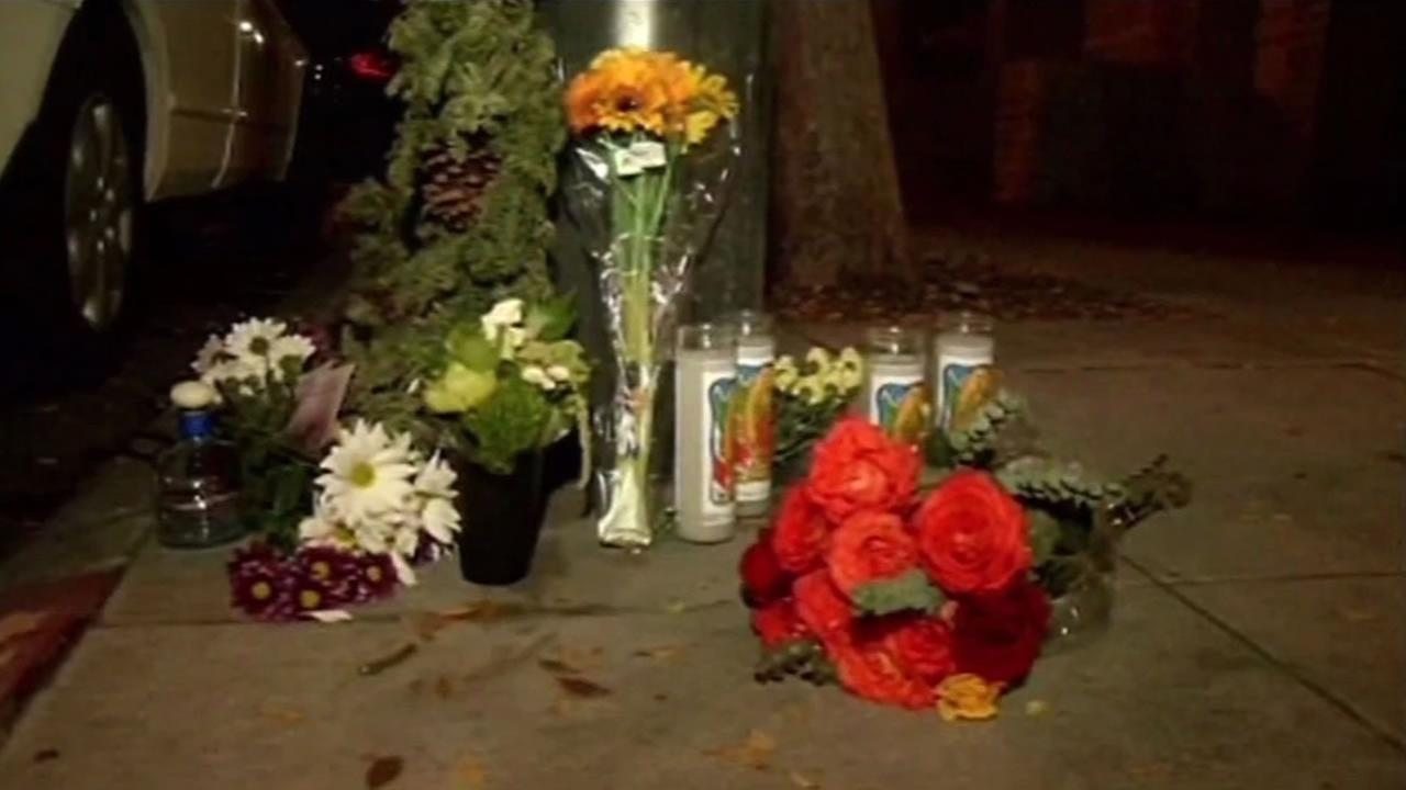 This image shows a memorial for a victims of a quadruple homicide in San Francisco in 2015.