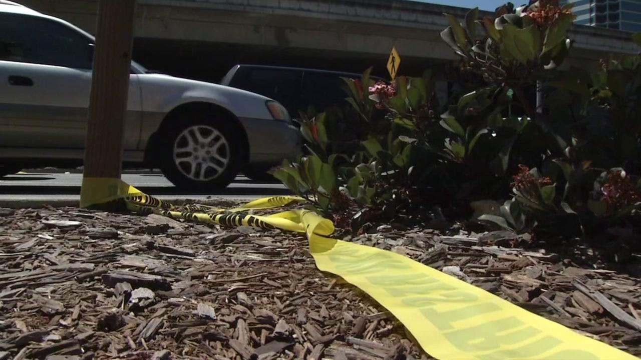 Crime scene tape is seen at the Powell Street off-ramp exit in Emeryville, Calif. after a man was shot in the head on Monday, August 1, 2016.