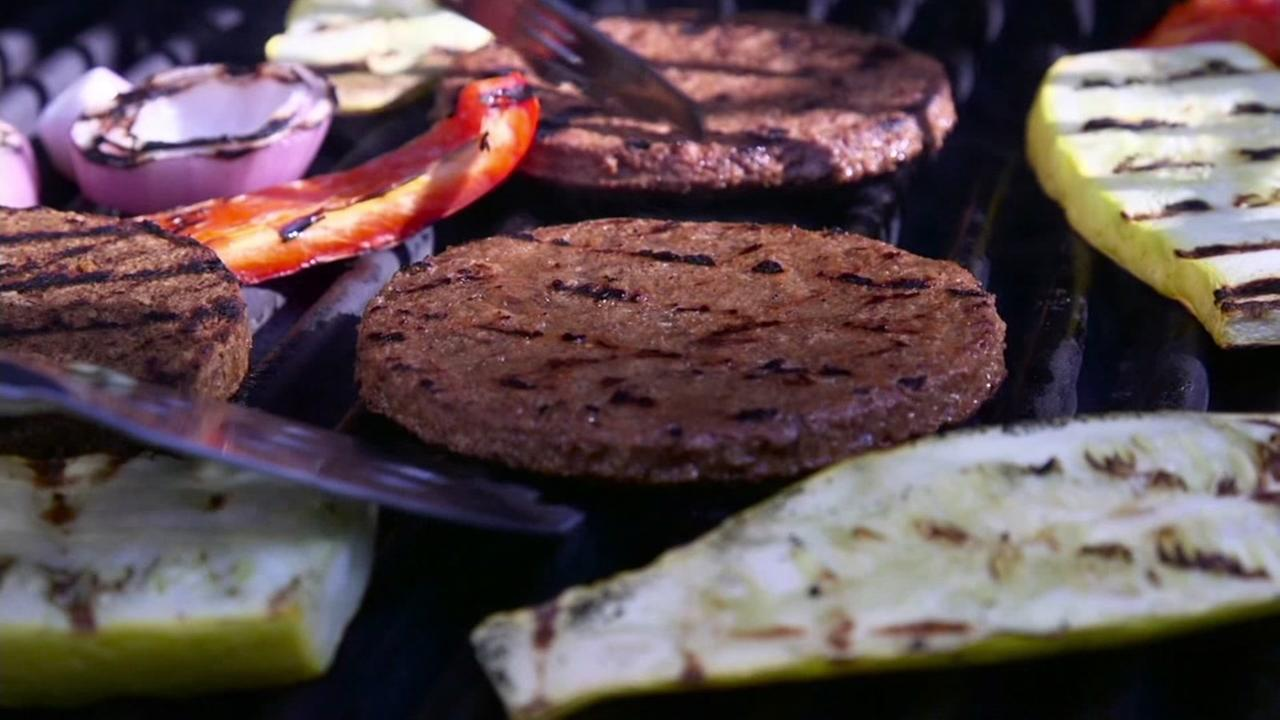 Veggie burgers are seen being cooked on a grill in this undated image.