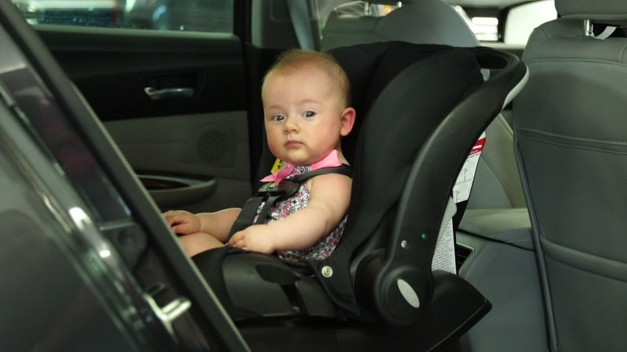 A child is seen in a car seat in this undated image.