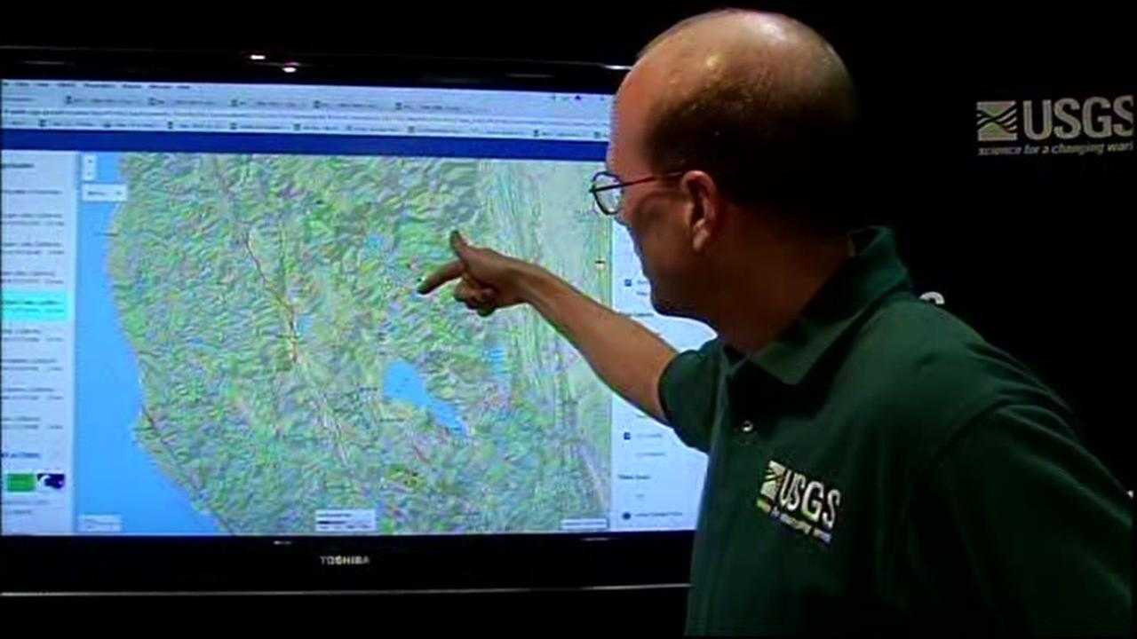 A man with the USGS is seen pointing at a monitor on Tuesday, August 9, 2016.