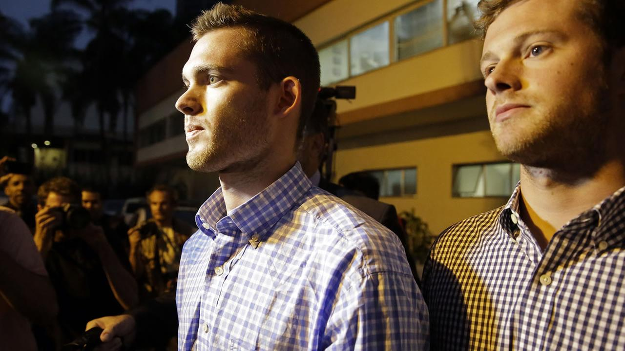 American Olympic swimmers Gunnar Bentz, left, and Jack Conger leave a police station in the Leblon neighborhood of Rio de Janeiro, Brazil, Thursday, Aug. 18, 2016.