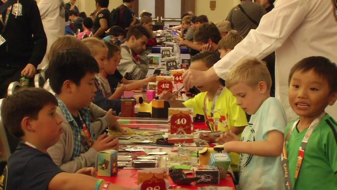 This image shows kids playing in the Pokemon World Championships in San Francisco on August 19, 2016.