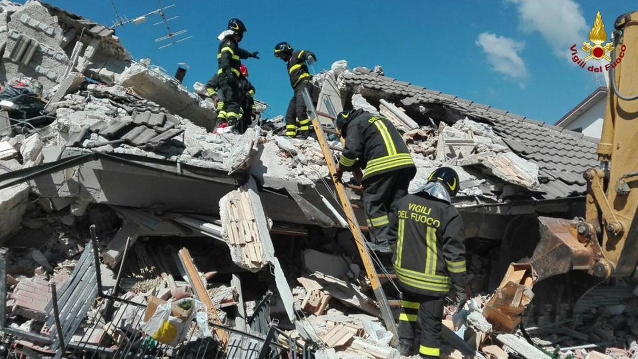 Firefighters search through debris of a collapsed building following an earthquake in Amatrice, central Italy, Wednesday, Aug. 24, 2016.