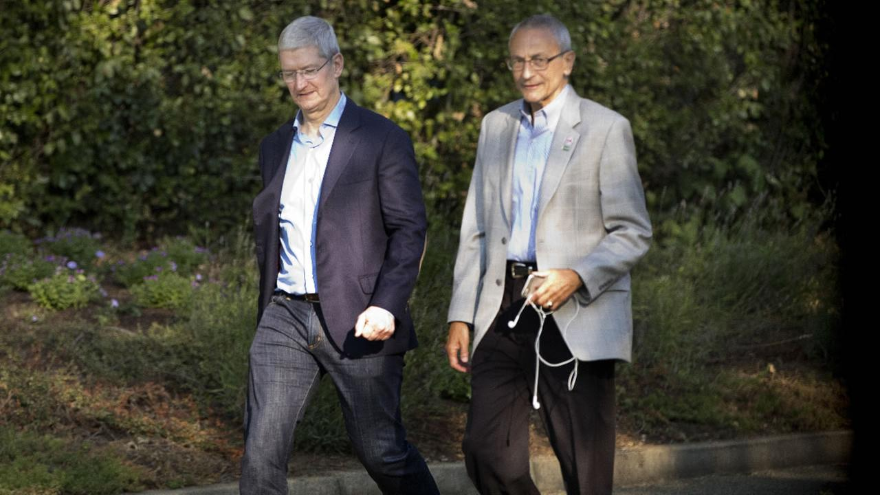 Apple CEO Tim Cook, left, and John David Podesta, Chairman of the 2016 Hillary Clinton campaign, are seen as they leave a fundraiser in Los Altos, Aug. 24, 2016.