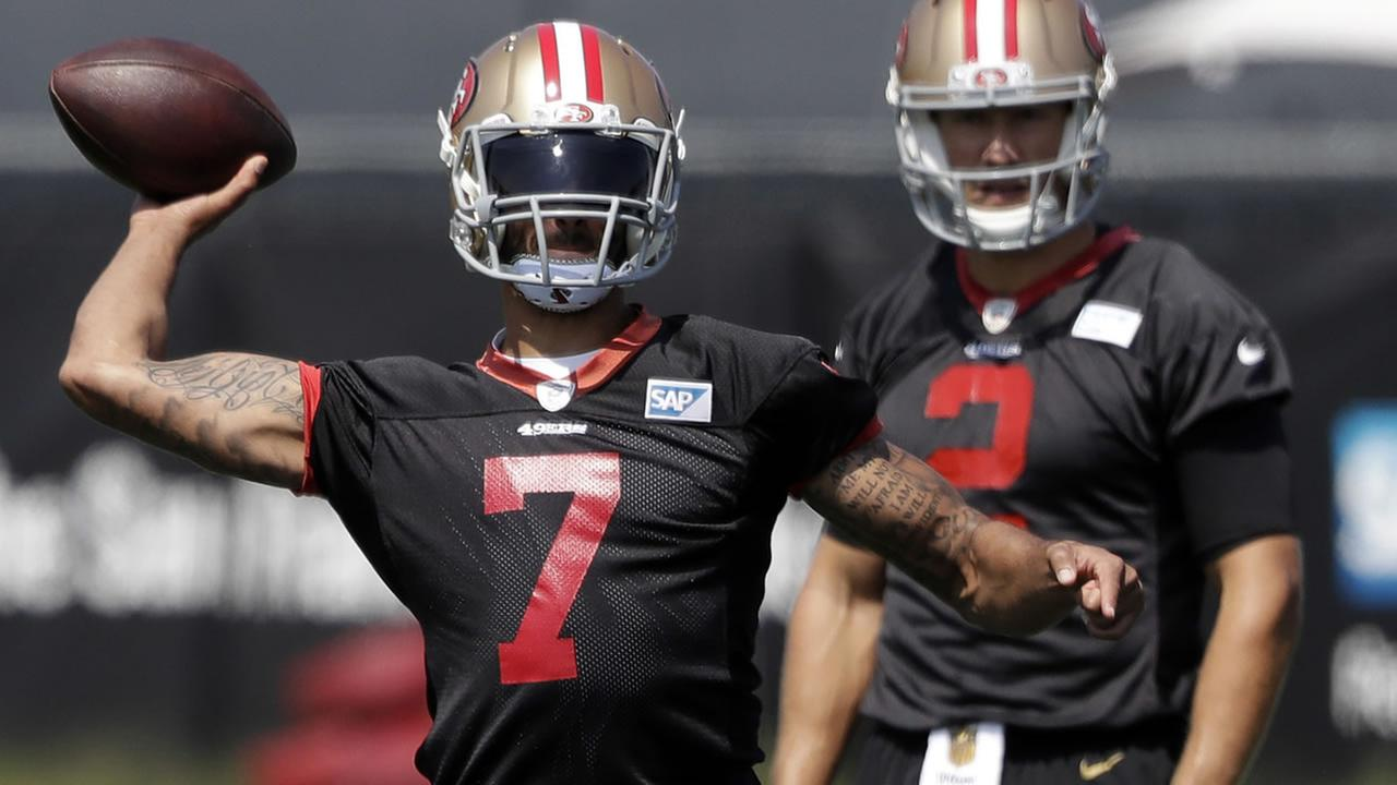 49ers quarterback Colin Kaepernick (7) throws as quarterback Blaine Gabbert watches during NFL football training camp in Santa Clara, Calif. on July 31, 2016.(AP Photo)