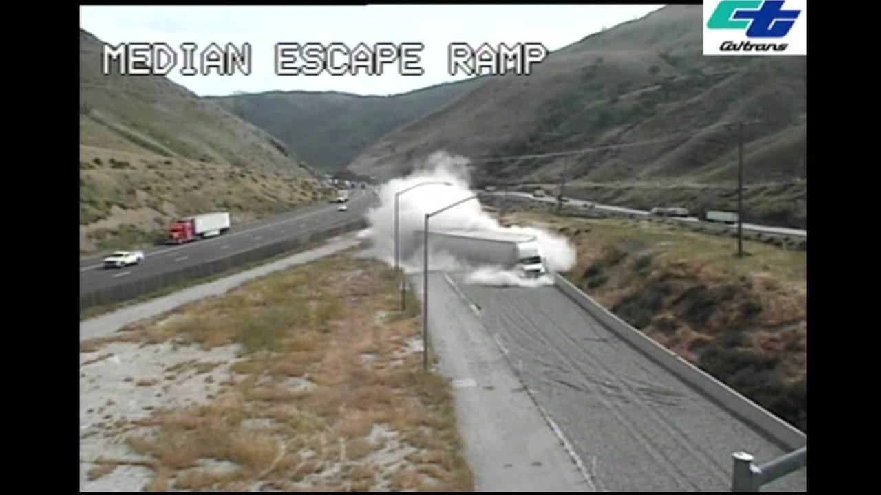 This image shows a big rig  using a runaway truck ramp after the driver loses control.