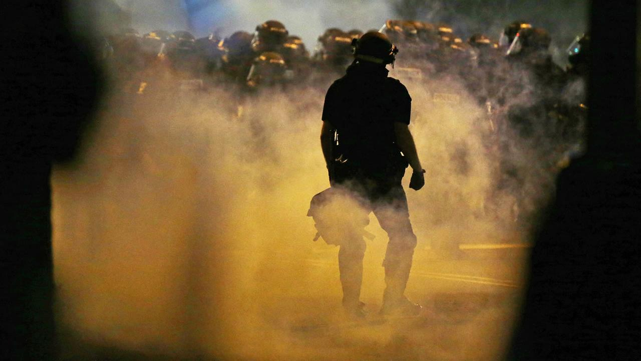 Police fire teargas as protestors converge on downtown following Tuesdays police shooting of Keith Lamont Scott in Charlotte, N.C., Wednesday, Sept. 21, 2016.