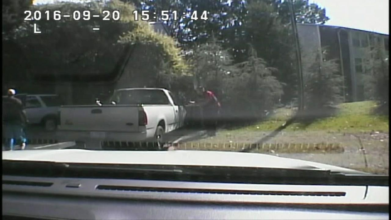 This image is a still from dashcam video of the fatal Charlotte police shooting.