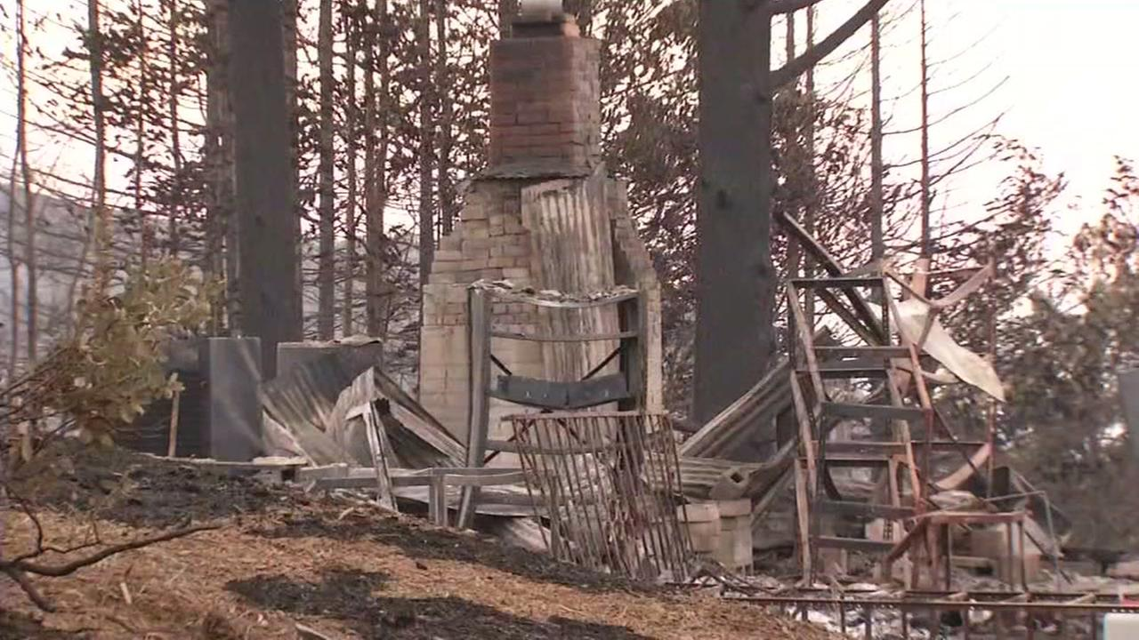 This image shows the charred remains of a home that burned in the Loma Fire in the Santa Cruz Mountains.
