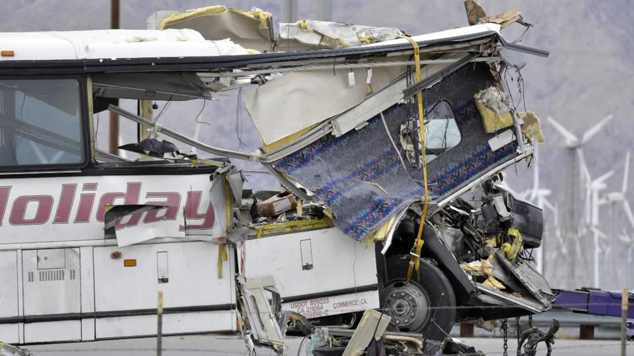 The damaged front of a tour bus is seen that crashed into the back of a semi-truck on I-10 just north of the desert resort town of Palm Springs, in Desert Hot Springs, Calif.