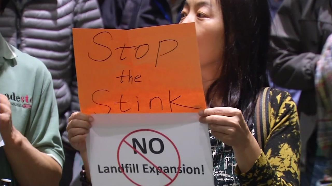 A woman holds up a sign protesting against the Newby Island Landfill in Milpitas, Calif. on Wednesday, October 26,  2016.