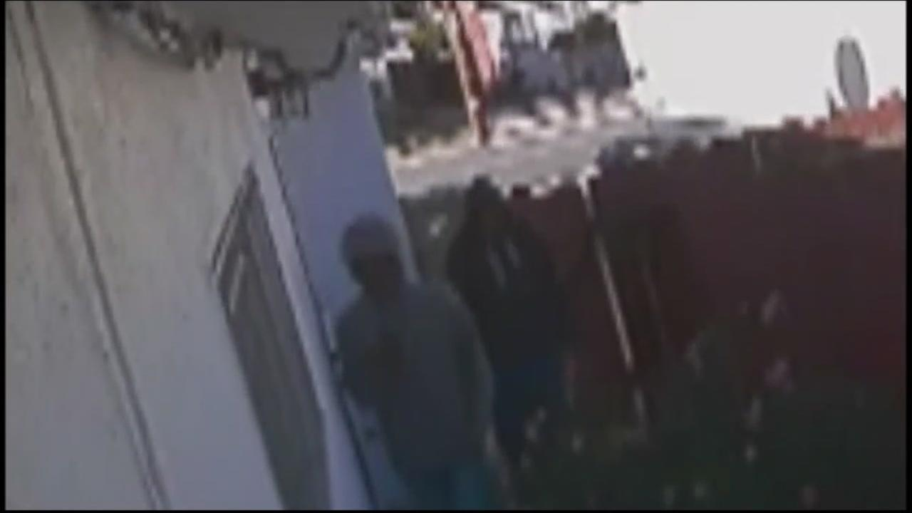 Surveillance video shows two suspects walking through a door at a home in San Leandro, Calif. in this undated image.