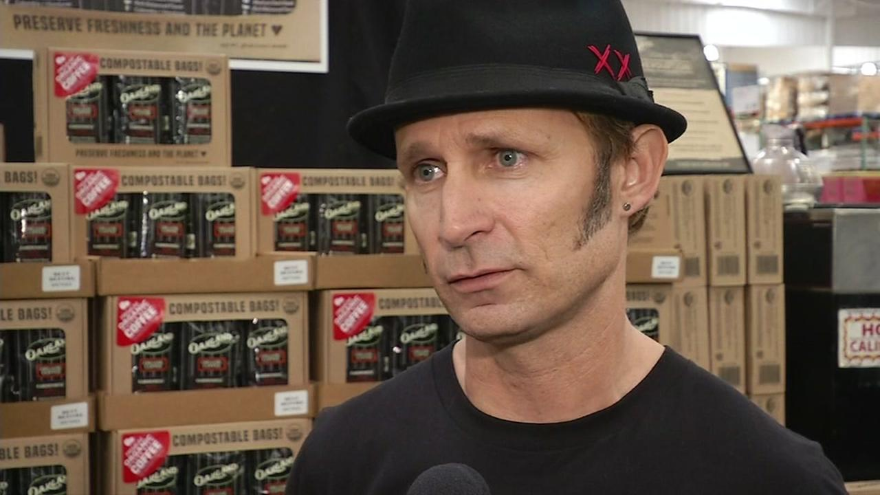 This image shows Green Day bassist Mike Dirnt selling his Oakland Coffee at a Costco.