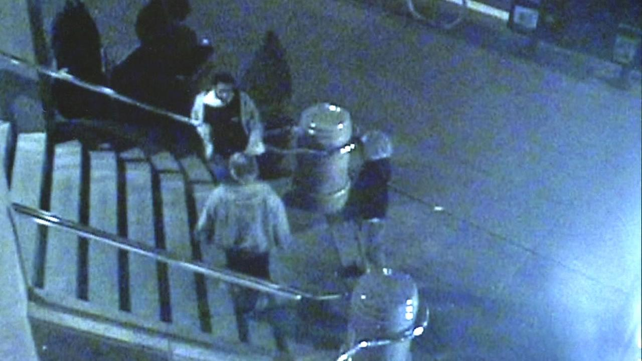 Surveillance video shows two men approaching a man on stairs in San Francisco, Calif. in November 2014.