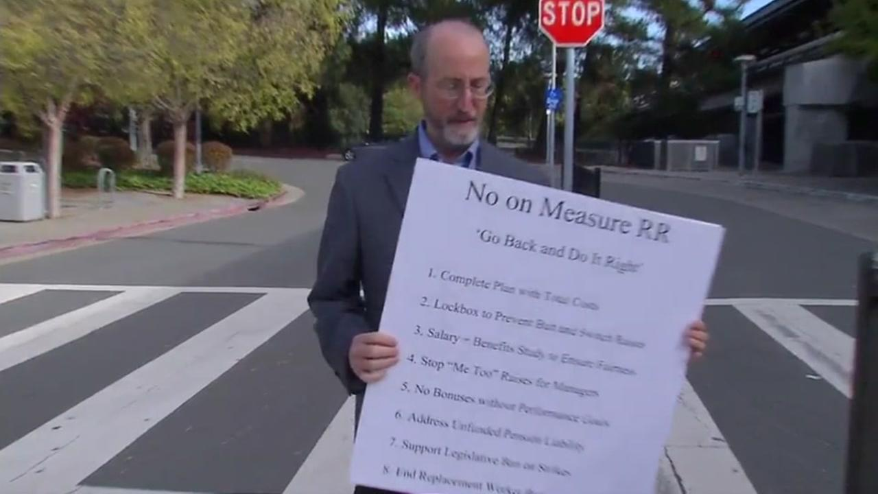 State Sen. Steve Glazer D-Walnut Creek holds a sign spelling out his opposition for ballot Measure RR.