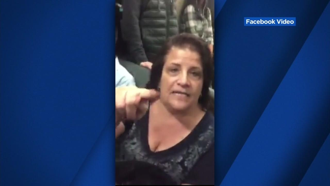 This image is a still from a video that was posted on Facebook showing a woman who launched into a racist rant at an Iranian woman on BART train.