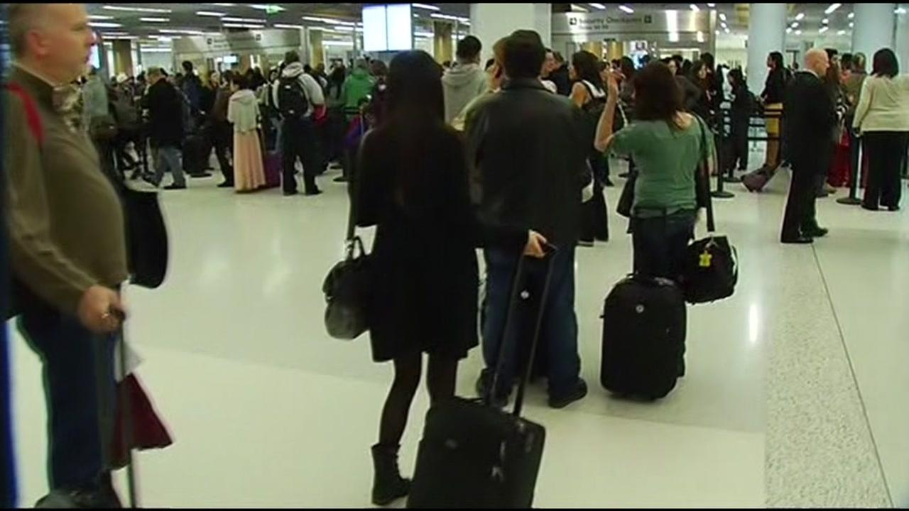 Travelers wait in long lines at the airport in this undated photo.