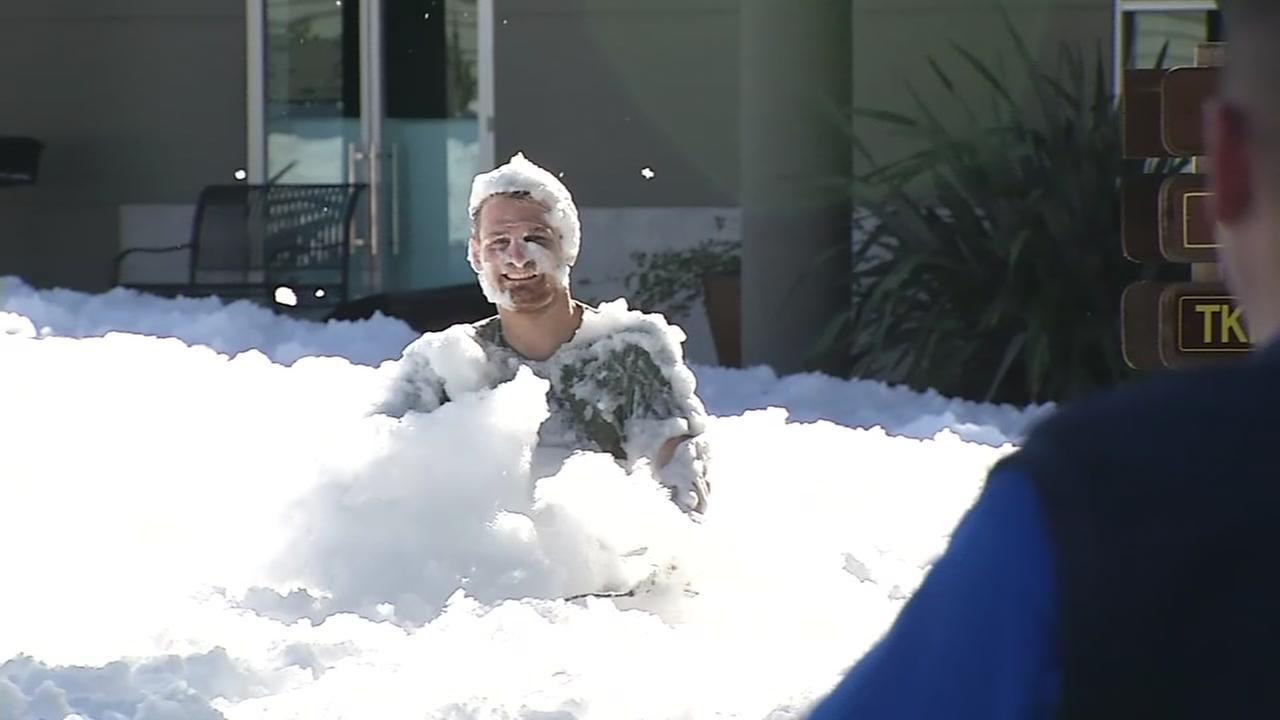 A man wades through foam in Santa Clara, Calif. on Nov. 8, 2016.