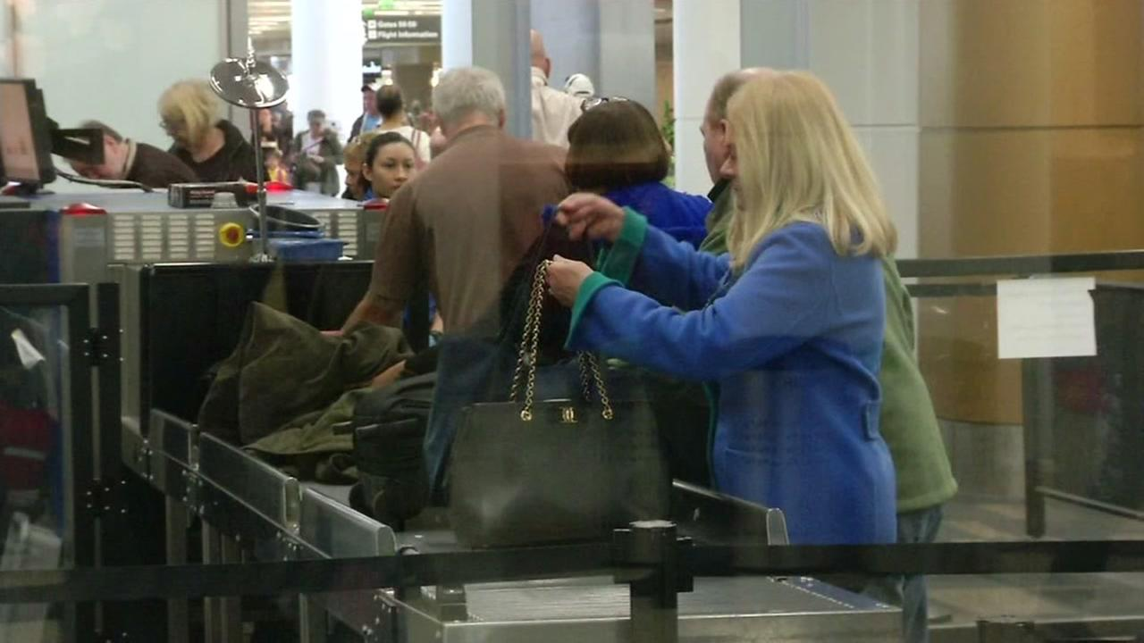 Travelers pass through airport security at the San Francisco International Airport on Nov. 23, 2016.