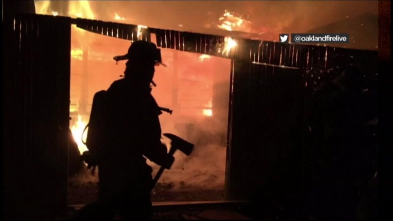 A firefighter fights a blaze in Oakland on Nov.26, 2016.