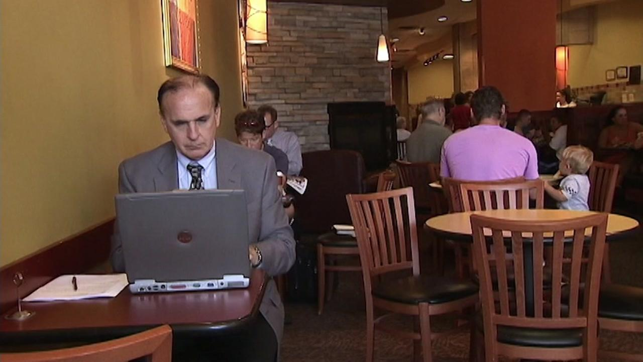 This is an undated image of a man using a laptop.