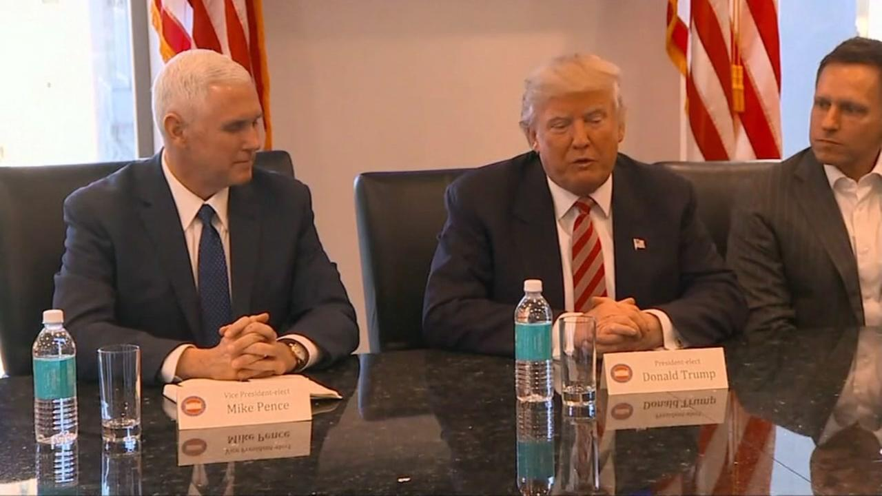 Donald Trump and Mike Pence appear in a conference room in Trump tower at a summit with Silicon Valley tech leaders on Dec. 14, 2016.