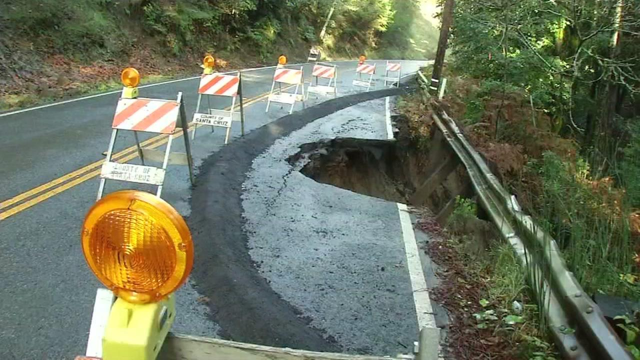 A large sinkhole is seen near Summit Road and Loma Prieta Avenue in the Santa Cruz Mountains on Friday, December 16, 2016.