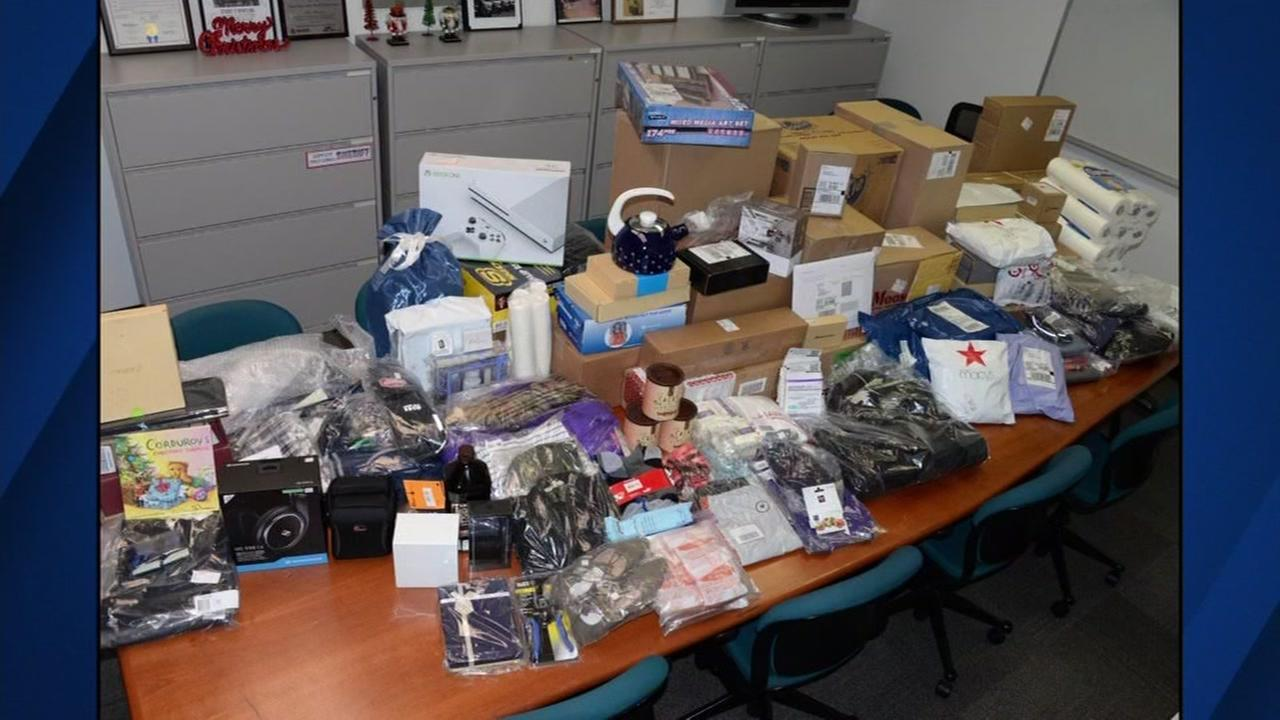 FILE - Photo shows gifts ripped off from a Cupertino UPS facility