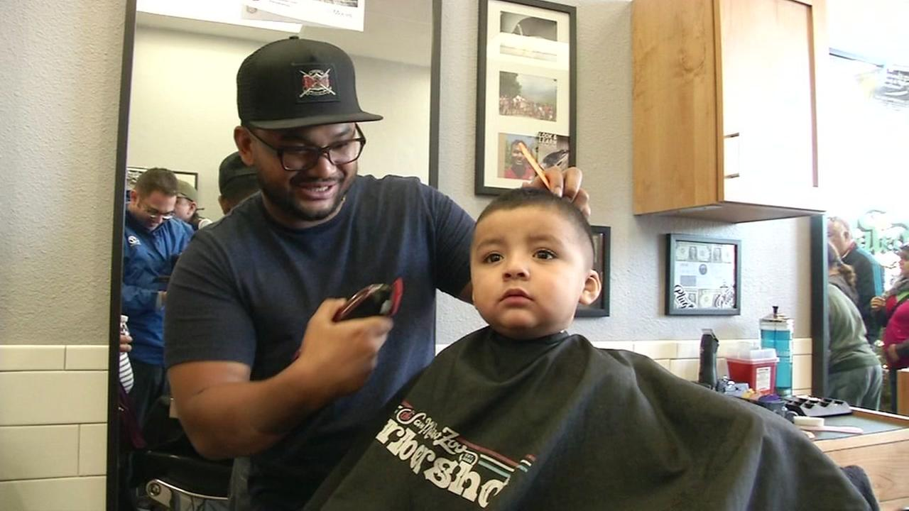A young boy is seen at the San Mateo Zoo Barbershop on Monday, December 19, 2016.