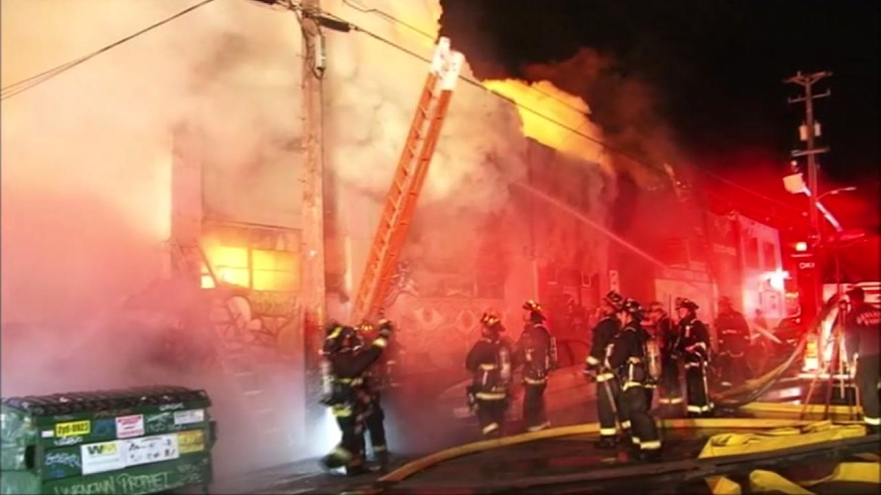 Firefighters battle a fire at the Ghost Ship warehouse on Friday, December 2, 2016.