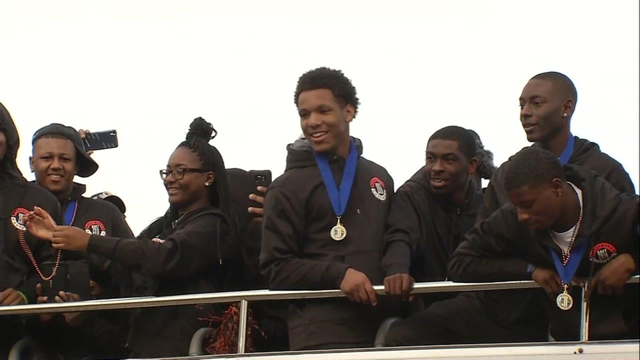 McClymonds High School football players celebrate on top of a bus in downtown Oakland on Jan. 6, 2016.