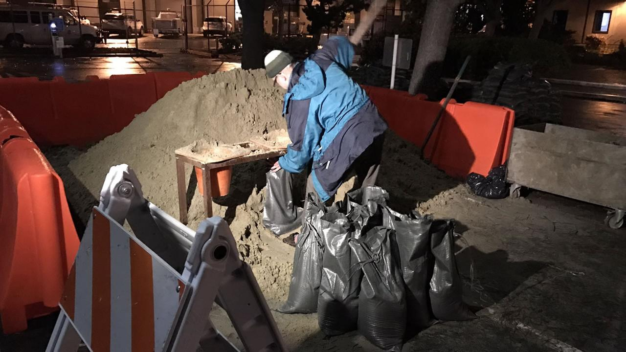 A man is seen preparing sandbags ahead of a major Bay Area storm on Jan. 7, 2017.