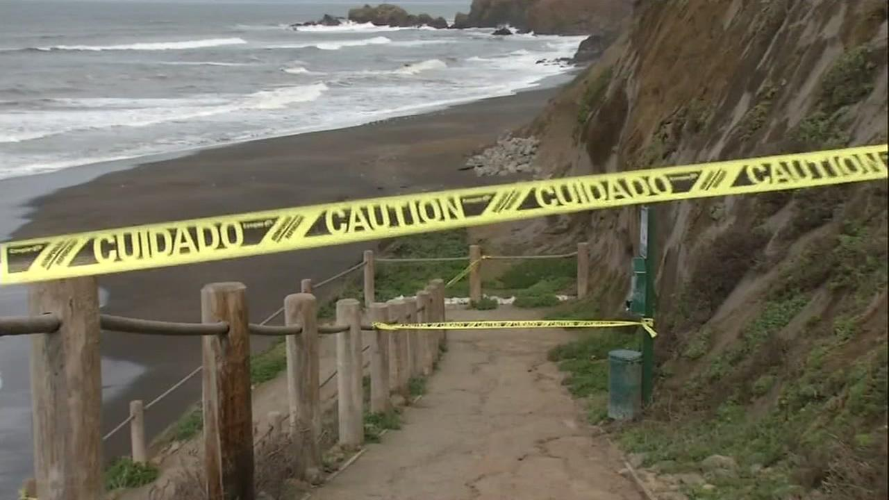Caution tape appears at a Pacifica, Calif. beachfront on Jan. 9, 2017.